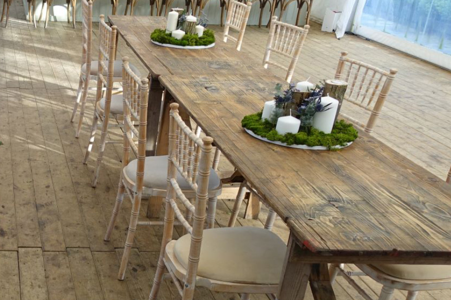 Limewash Chiavari Chairs with trestle tables