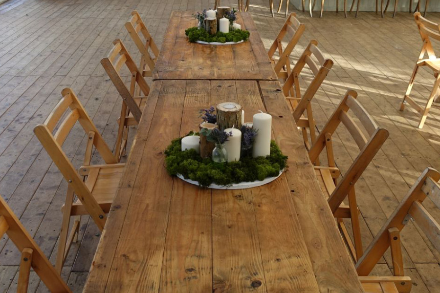 Rustic trestle tables, relaxed linen free look.