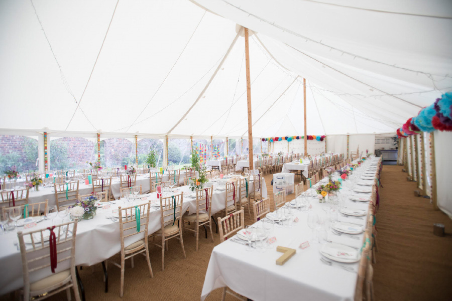 Traditional Marquee interior with long trestle banquet style tables