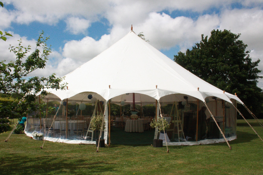 Traditional Petal Pole Marquee in a relaxed garden setting.