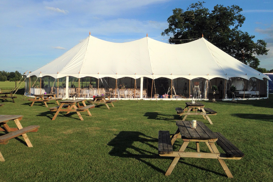 Traditional Petal Pole Marquee with additional picnic tables.