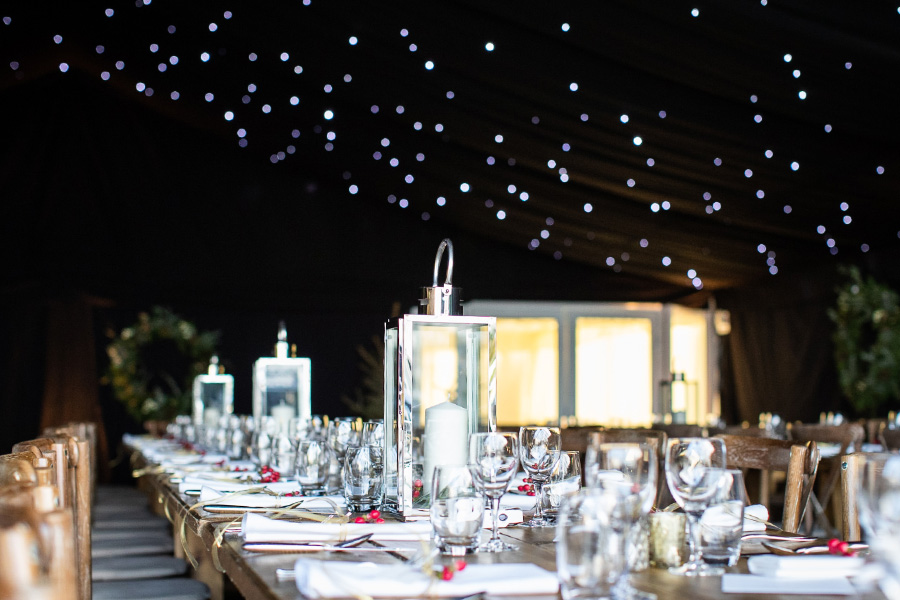 Classically laid tables with hurricane lamps